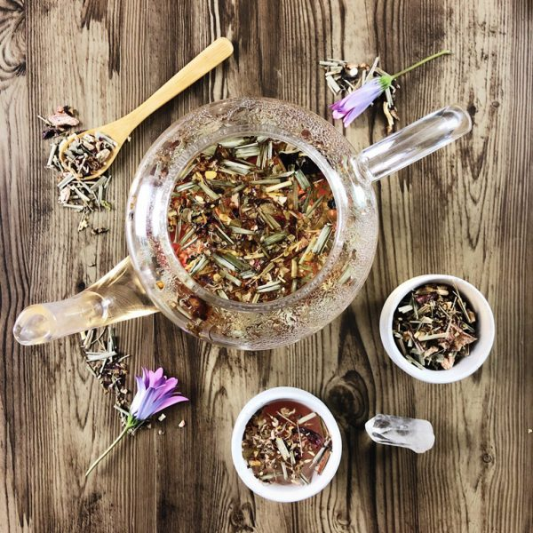 Wild Harvest herbal tea in a glass teapot