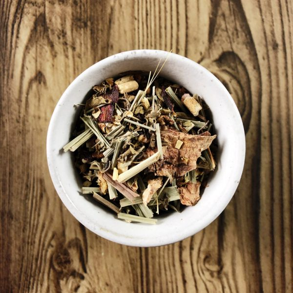Wild Harvest herbal tea leaves in a teacup