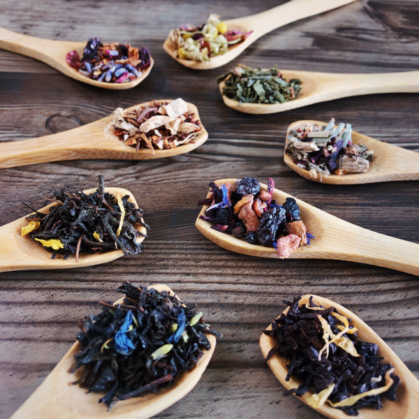 Wooden teaspoons piled with each blend of Bright Witch tea