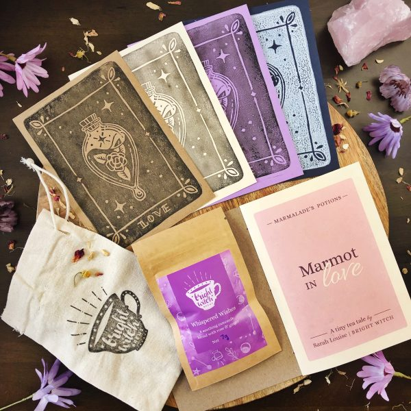 Marmalades Love Potion bundle with tea tale booklet, enchanted tea, handprinted art cards and hand-stamped cotton drawstring bag